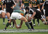 South African centre Stefan Watermeyer is put under pressure by New Zealand number 8 Liukanasi Manu during the Under 19 World Championship Final against South Africa at Ravenhill 2007.