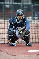 Catcher Juan Uriarte (17) of the Columbia Fireflies warms up before a game against the Charleston RiverDogs on Friday, April 5, 2019, at Segra Park in Columbia, South Carolina. Charleston won, 6-1. (Tom Priddy/Four Seam Images)