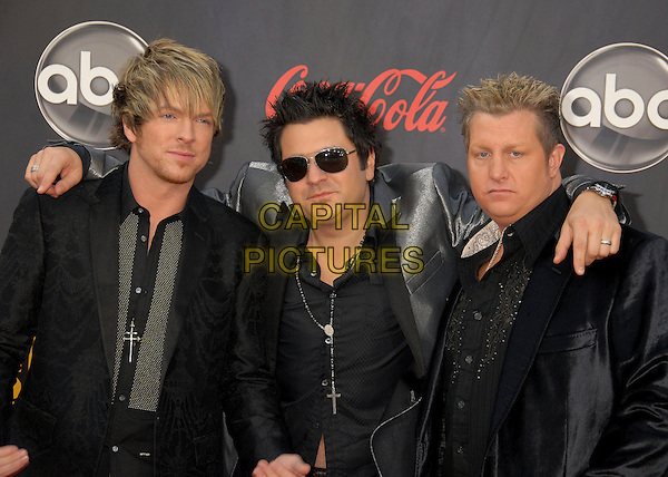 JOE DON ROONEY, JAY DeMARCUS & GARY LeVOX - RASCAL FLATTS.2007 American Music Awards at the Nokia Theatre LA Live, Los Angeles, California, USA..November 18th, 2007.half length black leather jacket sunglasses shades arms over shoulders .CAP/ADM/BP.©Byron Purvis/AdMedia/Capital Pictures.