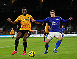 Willy Boly of Wolverhampton Wanderers tackles Harvey Barnes of Leicester City during the Premier League match at Molineux, Wolverhampton. Picture date: 14th February 2020. Picture credit should read: Darren Staples/Sportimage