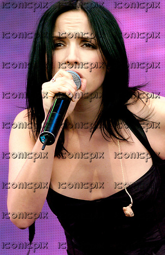 The Corrs - Andrea Corr - performing live at Capital FM's Party  in the Park in Hyde Park London UK - 11 Jul 2004.  Photo credit: George Chin/IconicPix