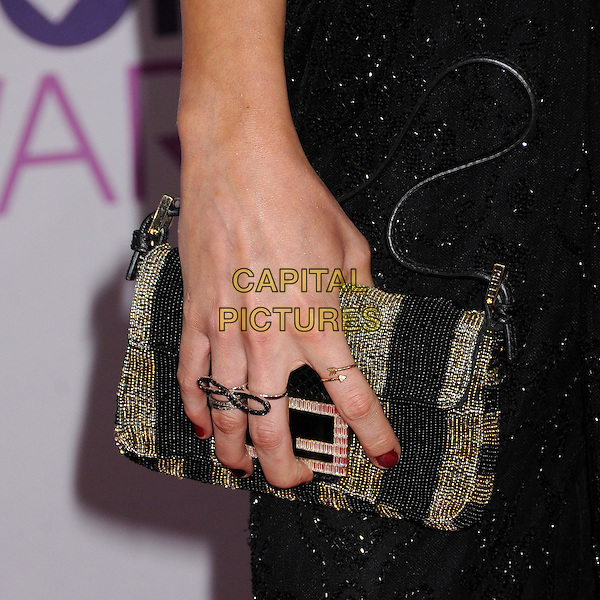 Katie Cassidy's hand.People's Choice Awards 2013 - Arrivals held at Nokia Theatre L.A. Live, Los Angeles, California, USA..January 9th, 2013.gold silver rings clutch bag stripe black sparkly.CAP/ADM/BP.©Byron Purvis/AdMedia/Capital Pictures.