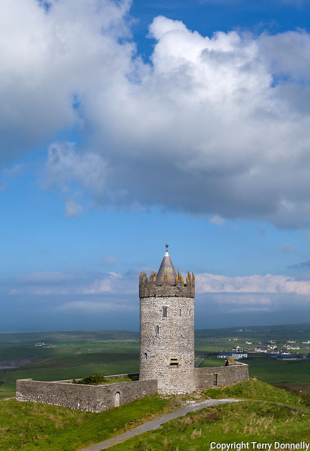 County Clare, Ireland:<br /> Round tower of Doonagore castle stands above the village of Doolin and the South Sound of Galway Bay