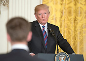 United States President Donald J. Trump listens to a reporter's question as he hosts a Joint Press Conference with the Baltic States Heads of Government, President Raimonds Vejonis of Latvia, President Kersti Kaljulaid of Estonia, and President Dalia Grybauskaite of Lithuania in the East Room of the White House in Washington, DC on Tuesday, April 3, 2018.<br /> Credit: Ron Sachs / CNP