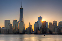 The sun rises next to 4 World Trade Center as the Freedom Tower (1 WTC) stands tall nearby in the World Trade Center complex, in New York City.