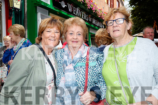 Geraldine Burke, Noreen O'Keeffe and Bernie Ryan at the Busking at the Market Cross in Killarney on Monday.