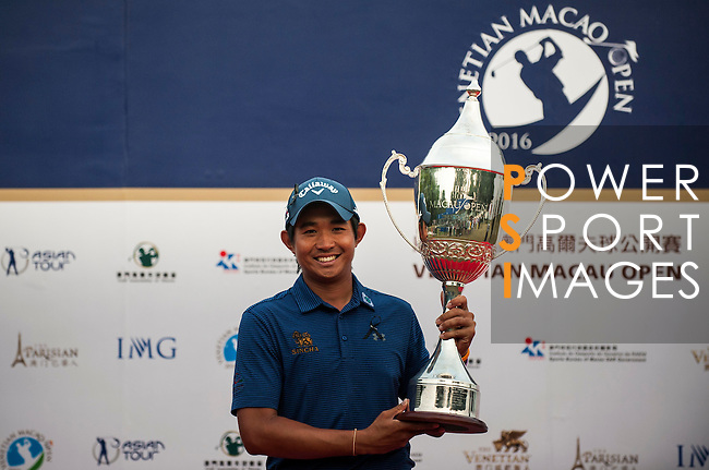 Pavit Tangkamolprasert of Thailand holds the trophy after winning the Venetian Macao Open 2016 at the Macau Golf and Country Club on 16 October 2016 in Macau, China. Photo by Marcio Machado / Power Sport Images