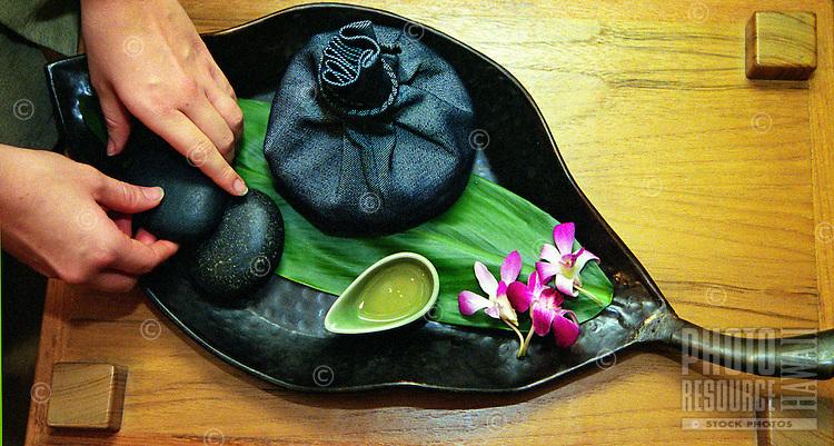 Pohaku stones used for Nonu ( noni ) treatment at a spa