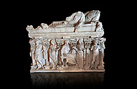 Roman sarcophagus with relief sculptures from Hierapolis . Hierapolis Archaeology Museum, Turkey<br /> <br /> Columned Sarcophagus Sarcopinagu of Euthios Pyrrnon, Asian Archon (ruler), Roman Period First quarter of third century A.D. Loadicea. <br />  <br /> Four sides of these sarcophagi are all in relief. They appear like a columned temple. The reliefs between the grooved columns are related to the private life of the individual. His/her education, heroic scenes and plant or mythological motifs are decorated in relief. The cover of the sarcophagus is arranged like a bed and it is depicted as the wife and the husband as lying on it. The name of the individual and some mythological reliefs are found in the surrounding of the cover. The two sarcophagi in the hall are of this kind. . Against an black background