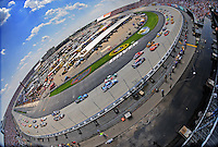 Jun 1, 2008; Dover, DE, USA; NASCAR Sprint Cup Series drivers go through turn one during the Best Buy 400 at the Dover International Speedway. Mandatory Credit: Mark J. Rebilas-US PRESSWIRE