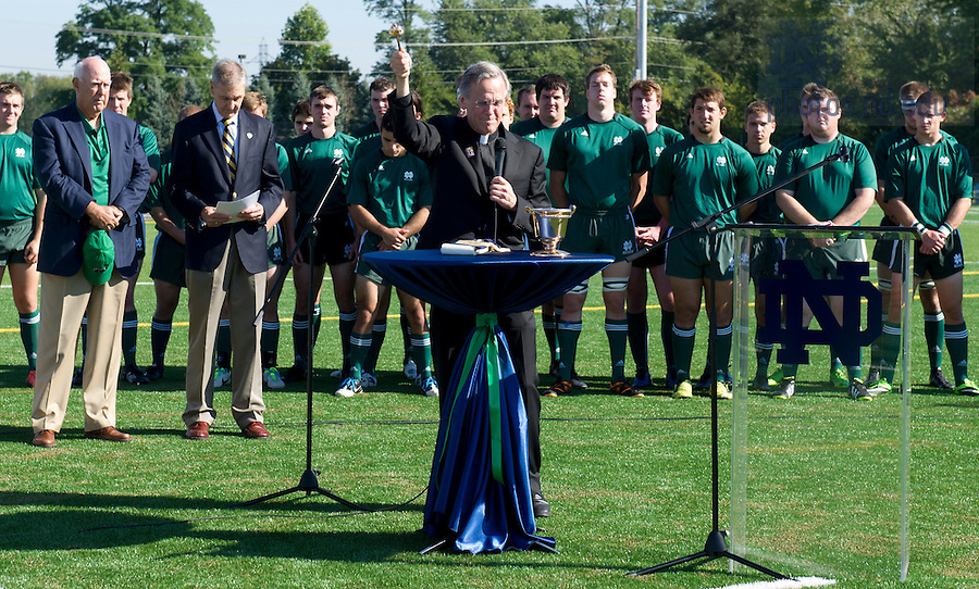 Sept. 28, 2013; University President Rev. John I. Jenkins, C.S.C, blesses the field during the  Stinson Rugby Field dedication. Photo by Barbara Johnston/University of Notre Dame