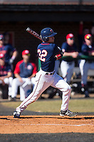 Dalton Hoiles (32) of the Shippensburg Raiders follows through on his swing against the Belmont Abbey Crusaders at Abbey Yard on February 8, 2015 in Belmont, North Carolina.  The Raiders defeated the Crusaders 14-0.  (Brian Westerholt/Four Seam Images)