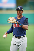 Scranton/Wilkes-Barre RailRiders third baseman Miguel Andujar (9) warms up before the first game of a doubleheader against the Rochester Red Wings on August 23, 2017 at Frontier Field in Rochester, New York.  Rochester defeated Scranton 5-4 in a game that was originally started on August 22nd but was postponed due to inclement weather.  (Mike Janes/Four Seam Images)