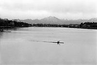 Segrate (Milano), un uomo fa canoa all'idroscalo. Le Alpi sullo sfondo --- Segrate (Milan), a man does canoe on the idroscalo (seadrome). The Alps on the background
