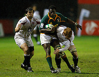 Photo: Richard Lane/Richard Lane Photography. England U20 v South Africa U20. Semi Final. 18/06/2008. South Africa's Thiliphaut Marole is tackled by England's Alex Corbisiero and Hugo Ellis (rt).
