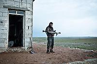 SYRIA: A YPG fighter remained on the rear base of the front line of the ciment plant.<br /> <br /> SYRIA: Un combattant YPG resté sur la base arrière de la ligne de front de la cimenterie.