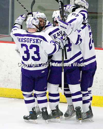 Ryan Warsofsky (Curry - 33), Steven Mohler (Curry - 15), Mike Kavanagh (Curry - 4), Michael Curran (Curry - 24) - The Curry College Colonels defeated the Becker College Hawks 5-1 in their ECAC Northeast Semi-Final matchup on Wednesday, March 2, 2011, at Max Ulin Rink in Milton, Massachusetts.