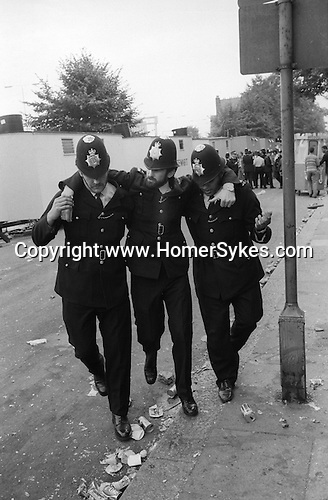 Notting hill Gate Carnival race riot, London W11 England 1976. Police hurt carried away.