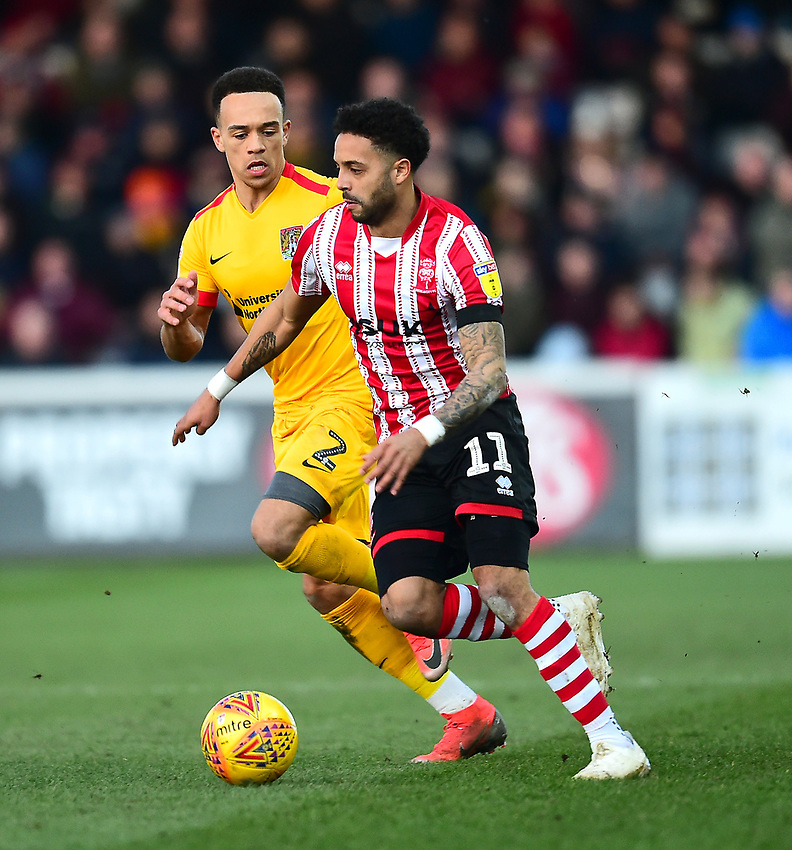 Lincoln City's Bruno Andrade gets past Northampton Town's Shay Facey<br /> <br /> Photographer Andrew Vaughan/CameraSport<br /> <br /> The EFL Sky Bet League Two - Lincoln City v Northampton Town - Saturday 9th February 2019 - Sincil Bank - Lincoln<br /> <br /> World Copyright © 2019 CameraSport. All rights reserved. 43 Linden Ave. Countesthorpe. Leicester. England. LE8 5PG - Tel: +44 (0) 116 277 4147 - admin@camerasport.com - www.camerasport.com