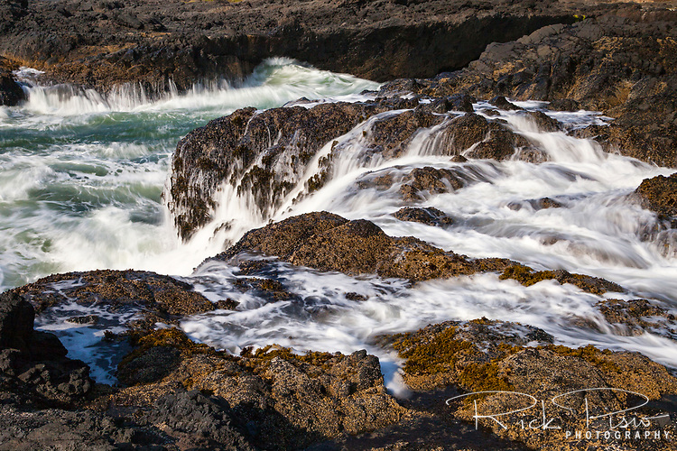 Water surges from tidal action at Cape Perpetua Scenic Area along Oregon's Central Coast south of Yachats.