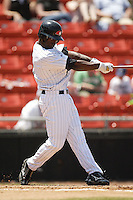 Hickory center fielder Andrew McCutchen (1) follows through on his swing in first inning action versus Asheville at L.P. Frans Stadium in Hickory, NC, Sunday, May 21, 2006.  Hickory defeated Asheville 5-4.