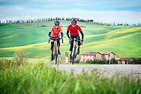 Cyclists road riding in the Tuscan region of Italy while on a tour of the gravel roads called Strade Bianche