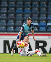 Will De Havilland of Wycombe Wanderers stands over James Collins of Crawley Town during the Sky Bet League 2 match between Wycombe Wanderers and Crawley Town at Adams Park, High Wycombe, England on 25 February 2017. Photo by Andy Rowland / PRiME Media Images.
