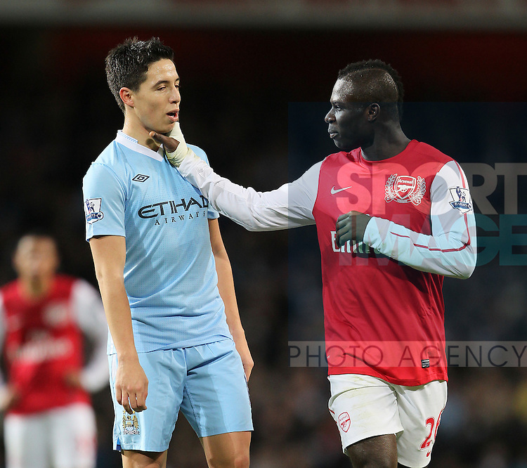 Arsenals Emmanuel Frimpong gets to grips with with Manchester Citys Samir Nasri