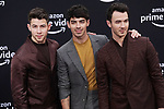 a _Nick Jonas, Joe Jonas, Kevin Jonas 100 arrives at the Premiere Of Amazon Prime Video's Chasing Happiness at Regency Bruin Theatre on June 03, 2019 in Los Angeles, California.