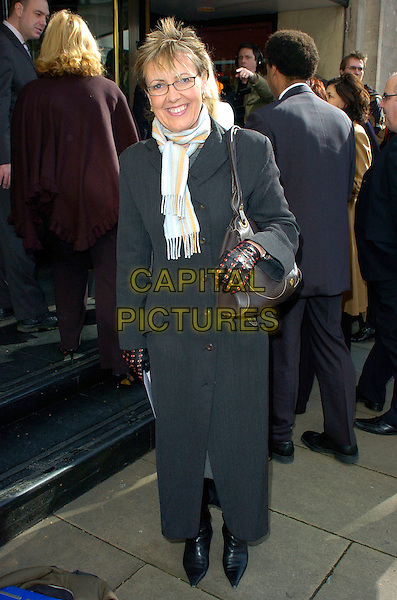AGGIE MacKENZIE.Arrivals at the Television & Radio Industries Club (TRIC) Awards at Grosvenor House, London, UK..March 6th, 2007.full length black coat gloves scarf .CAP/CAN.©Can Nguyen/Capital Pictures