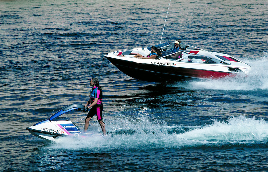 Skiboat and Jetski running side by side at Lake Powell. boats, water sports, jetskiing, female jetskier, boat. Utah, Lake Powell.