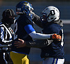 Kevon Hall #32 of Conference II/III (Roosevelt), center, gets congratulated by teammate Brendan Pataky #62 (Division Avenue) after rushing for his second touchdown against Conference I/IV in the Nassau County Senior Bowl at Mitchel Athletic Complex in Uniondale on Thursday, Nov. 22, 2018.