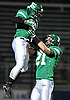 Farmingdale No. 27 Steve Kunz, right, hoists running back No. 30 Jordan McLune into the air after he rushed for a 16-yard touchdown in the second quarter of a Nassau County varsity football Conference I semifinal against East Meadow at Hofstra University on Saturday, Nov. 14, 2015.<br /> <br /> James Escher
