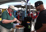 Paul Whitney, left, serves chili during the Beer and Chili Festival at the Grand Sierra Resort in Reno, Nevada on Saturday, Oct. 21, 2017.