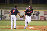 AZL Indians third baseman Henry Pujols (28) is congratulated by manager Anthony Medrano (8) after hitting his eighth home run of the season against the AZL Padres on August 30, 2017 at Goodyear Ball Park in Goodyear, Arizona. AZL Padres defeated the AZL Indians 7-6. (Zachary Lucy/Four Seam Images)