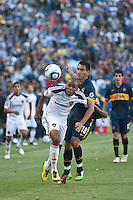 Tristan Bowen (17) tries to break free from defender Luciano Fabian Monzon (18) during the second half of a friendly between LA Galaxy and Boca Juniors. The game was held at the Home Depot Center in Carson, CA on May 23, 2010. The final score was LA Galaxy 1, Boca Juniors 0.
