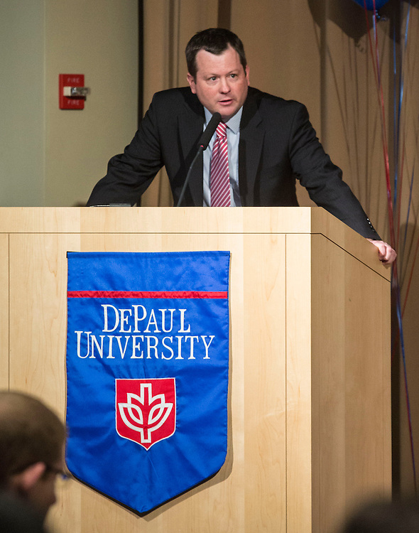 Greg Greenwell, director of sports information and media relations at DePaul University Athletics, greets the crowd at a press conference Monday, March 30, 2015, where Dave Leitao was introduced as the new head coach of the men's basketball program. (DePaul University/Jamie Moncrief)