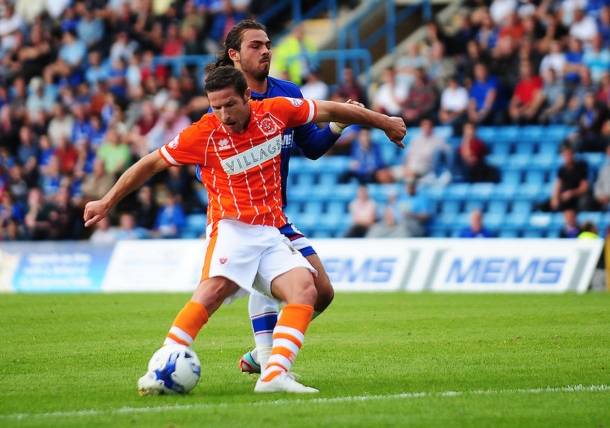 Blackpool's David Norris gets in a shot, under pressure from Gillingham's Bradley Dack<br /> <br /> Photographer Kevin Barnes/CameraSport<br /> <br /> Football - The Football League Sky Bet League One - Gillingham v Blackpool - Saturday 12th September 2015 - MEMS Priestfield Stadium - Gillingham<br /> <br /> &copy; CameraSport - 43 Linden Ave. Countesthorpe. Leicester. England. LE8 5PG - Tel: +44 (0) 116 277 4147 - admin@camerasport.com - www.camerasport.com
