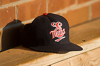 An Elizabethton Twins hat sits in the visitors dugout at Howard Johnson Field July 3, 2010, in Johnson City, Tennessee.  Photo by Brian Westerholt / Four Seam Images