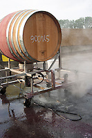 Mas La Chevaliere. near Beziers. Languedoc. Machine for cleaning empty barrels with hot water and steam outside the cellar. France. Europe.