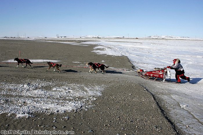 Wednesday March 14, 2007   ----   Ramy Brooks crosses on beach sand as nears the Nome finish line