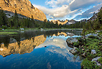 Wind River Range, WY: Horseshoe Lake reflecting clouds and morning light on Mitchell Peak and distant Warrior Peaks from Lizard Head Meadows;
