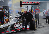 Mar. 10, 2012; Gainesville, FL, USA; NHRA crew chief Richard Hogan directs top fuel dragster driver Steve Torrence during qualifying for the Gatornationals at Auto Plus Raceway at Gainesville. Mandatory Credit: Mark J. Rebilas-