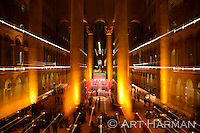 Washington DC's National Building Museum is a beautiful venue for events. I took this from an upper level showing off the event and the beauty of the building--and used a special technique to get the light streaks. By Art Harman