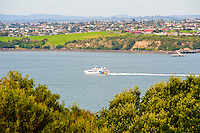 Fullers Ferry from Auckland to Waiheke Island, Waitemata Harbour, Auckland, North Island, New Zealand. Auckland, situated in the Hauraki Gulf of North Island is the largest and most populated city in New Zealand. With plenty to do within the city, and endless beautiful scenery on the surrounding islands and area just outside Auckland, it is easy to see why it is most people's first stop on a tour of New Zealand.