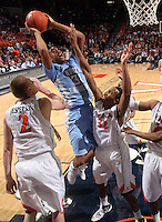 North Carolina Tar Heels forward John Henson (31) shoots the ball in front of Virginia Cavalier defenders during the game in Charlottesville, Va. North Carolina defeated Virginia 54-51.