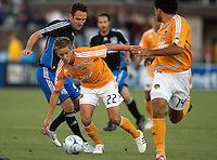22 May 2008: Stuart Holden of the Dynamo dribbles the ball away from Ryan Cochrane of the Earthquakes during the first half of the game at Buck Shaw Stadium in San Jose, California.   San Jose Earthquakes and Houston Dynamo are tied 0-0 at halftime.