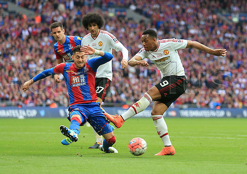 21.05.2016. Wembley Stadium, London, England. The Emirates FA Cup Final. Manchester United versus Crystal Palace. Anthony Martial of Manchester United sees his shot blocked by Joel Ward of Crystal Palace.