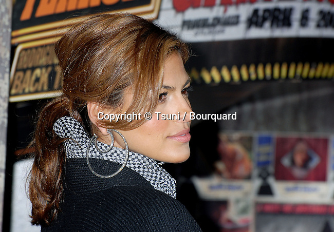 Eva Mendes arriving at the Grindhouse Premiere at the Orpheum Theatre In Los Angeles.<br /> <br /> headshot<br /> profil<br /> earring<br /> horizontale