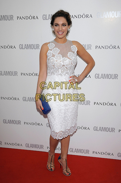 Kelly Brook.Women Of The Year 2012 - Glamour Awards, Berkeley Square, London, England..29th May 2012.full length white lace dress sleeveless hand on hip blue clutch bag.CAP/PL.©Phil Loftus/Capital Pictures.